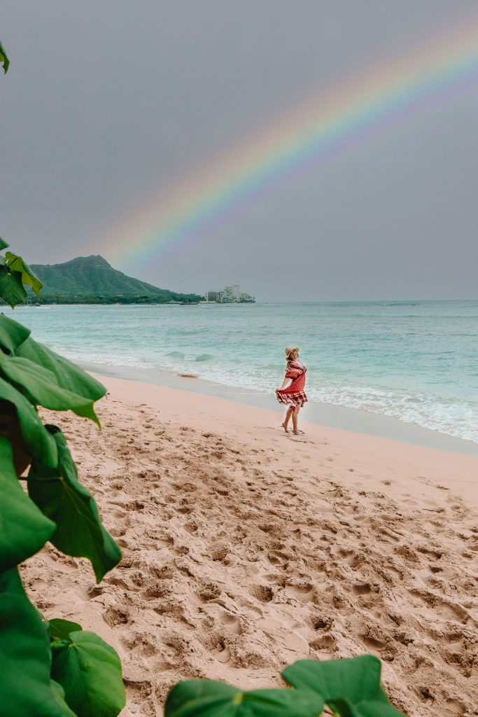 A woman enjoying Waikiki beach during her time on Oahu