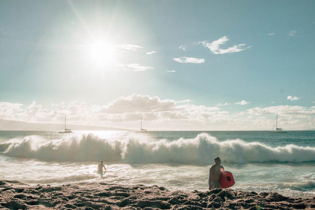 Black Rock Beach surfers at sunset
