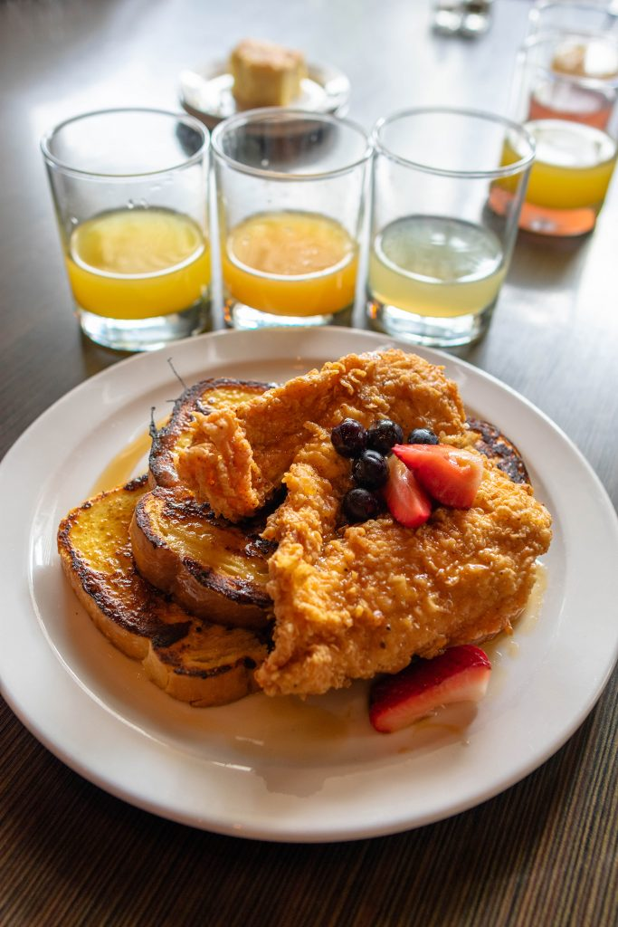 A mimosa flight and chicken and toast from Isa's French Bistro in Asheville.