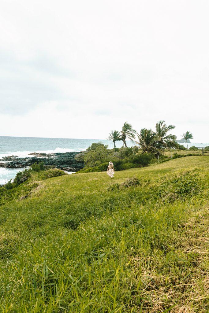A woman enjoying ocean views at Hana Maui Resort