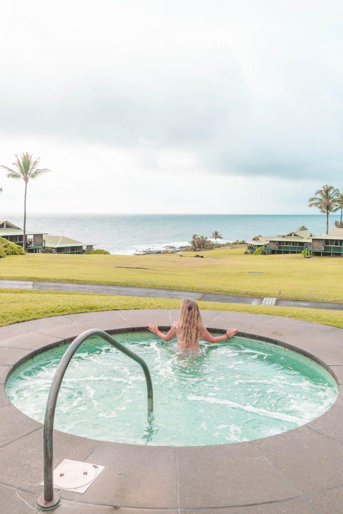 A woman sitting in a hot tub at Hana Maui Resort on Road to Hana