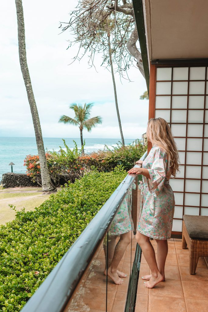 A woman on her private balcony at Napili Kai Beach Resort