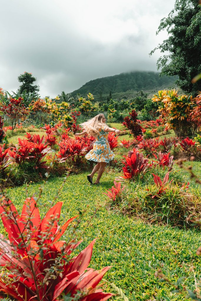 A woman dancing through gardens found on Road to Hana in Maui