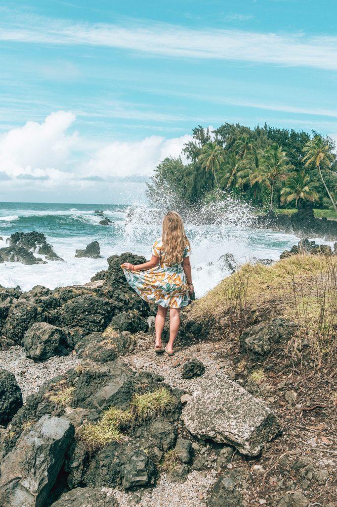 A woman enjoying Road to Hana on a 10 day Oahu and Maui itinerary