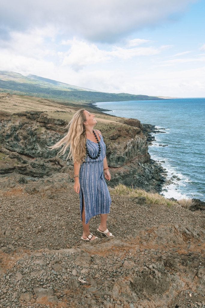A woman at a scenic overlook on Road to Hana in Maui