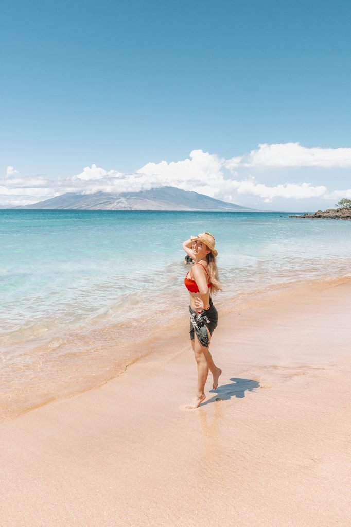A woman enjoying a beach day in Wailea, which is part of a 10 day Oahu and Maui itinerary