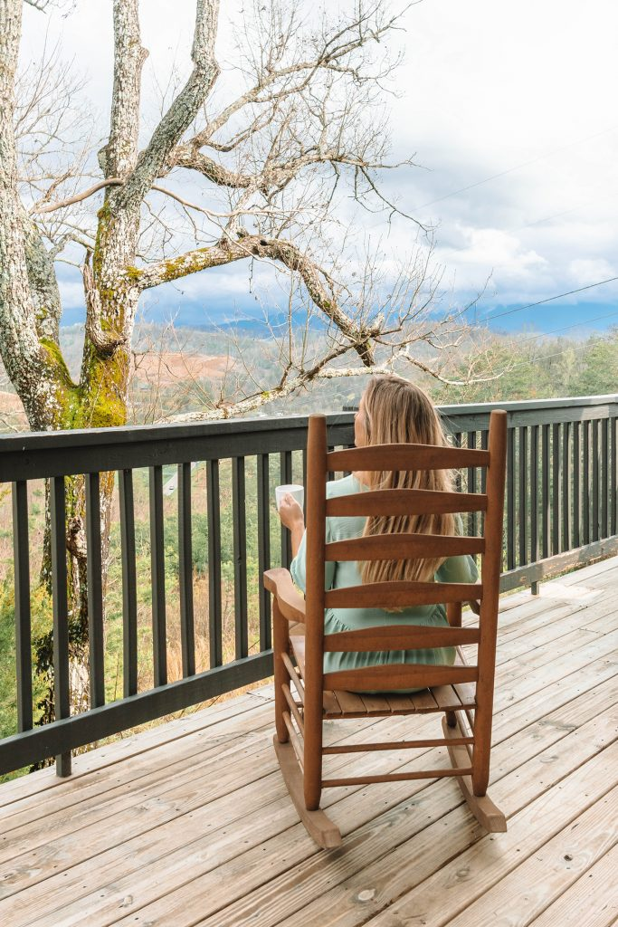A woman enjoying coffee with mountain views during 3 Days in the Great Smoky Mountains