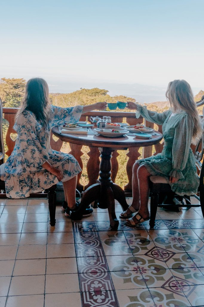 Two women enjoying breakfast with a view at Hotel Belmar during 2 days in Monteverde, Costa Rica