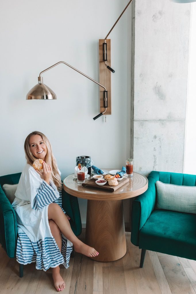 A woman enjoying breakfast at Kimpton Pittman Dallas during her one day and night in the city