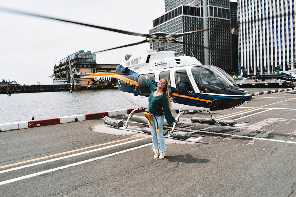 A woman enjoying a helicopter ride in NYC.