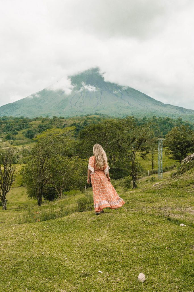 A woman admiring the views of Arenal Volcano