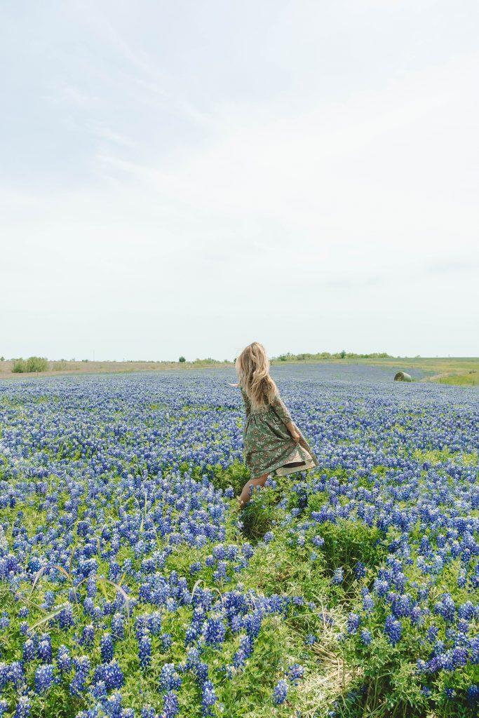 A woman in the bluebonnet fields of Ennis, Texas