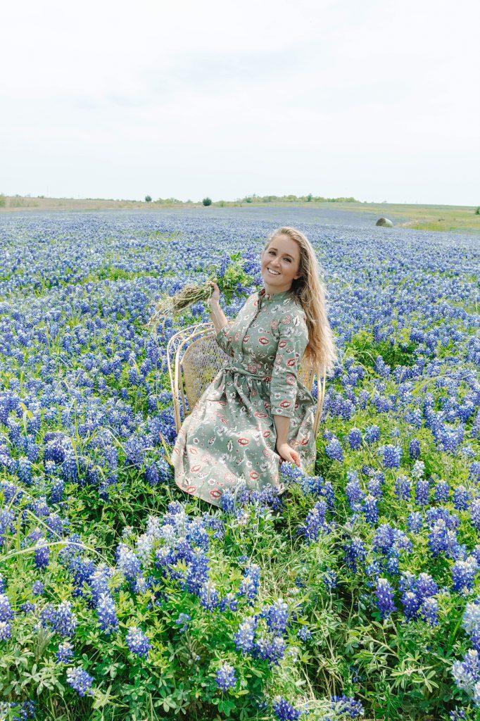 A woman enjoying bluebonnet season in Ennis, Texas