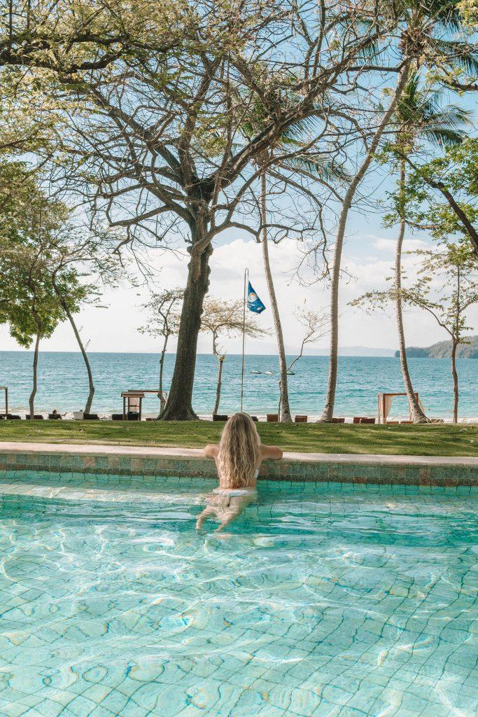 A woman enjoying the exclusive adults-only pool at Four Seasons Resort Costa Rica at Peninsula Papagayo
