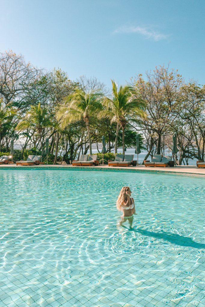 A woman at the stunning Blanca Pool at the exclusive Four Seasons Resort Costa Rica at Peninsula Papagayo