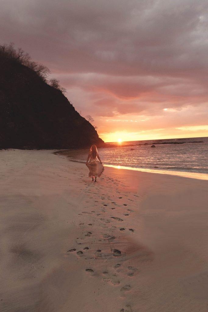 A woman enjoying the sunset at Four Seasons Costa Rica