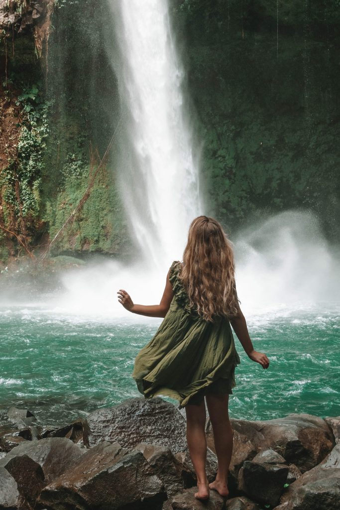 A woman at La Fortuna Waterfall in the Arenal area