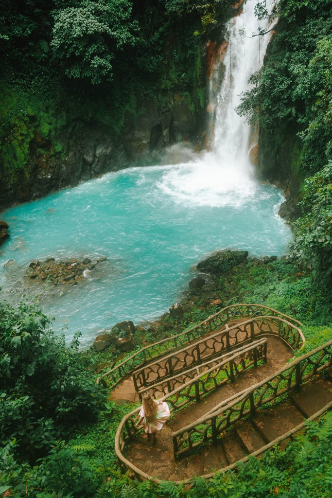 A woman enjoying a day trip to Rio Celeste from La Fortuna and Arenal