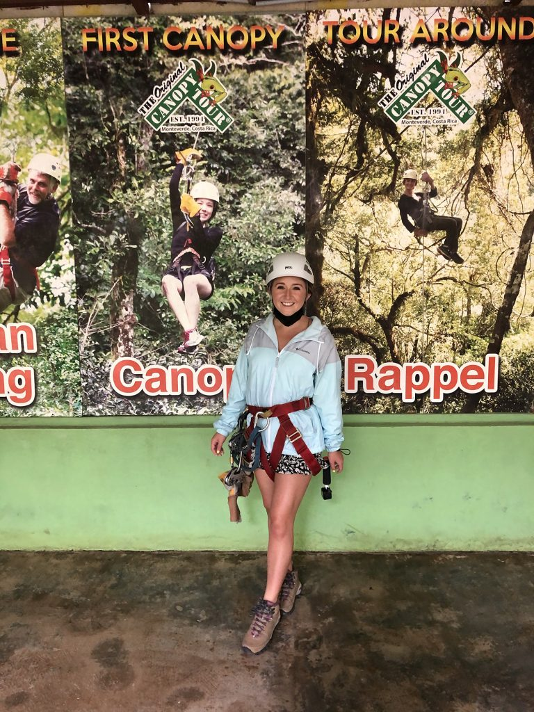 A woman excited to go zip lining in Costa Rica at The Original Canopy Tour