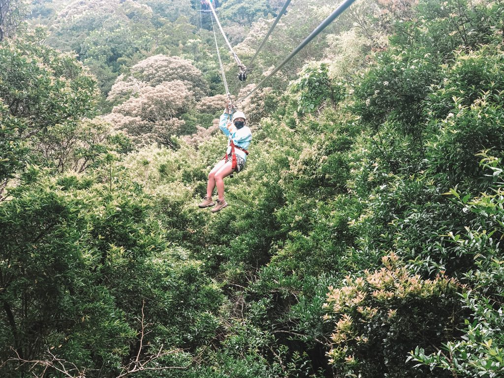 A woman zip lining through the cloud forest in Monteverde, Costa Rica