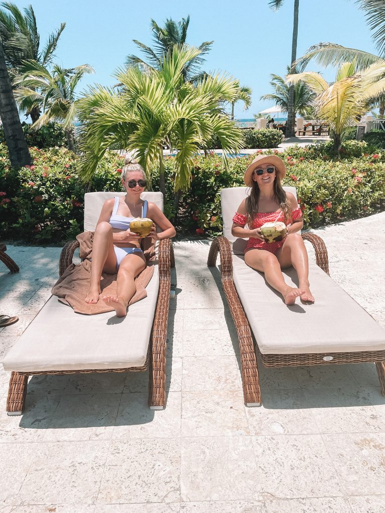 Two women enjoying a coconut and having a memorable time at Hyatt Ziva All Inclusive in Montego Bay