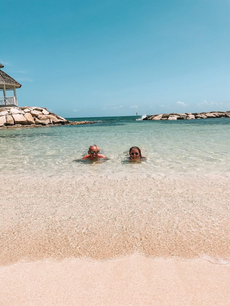 A father and daughter having a memorable experience at an all inclusive resort in the Caribbean