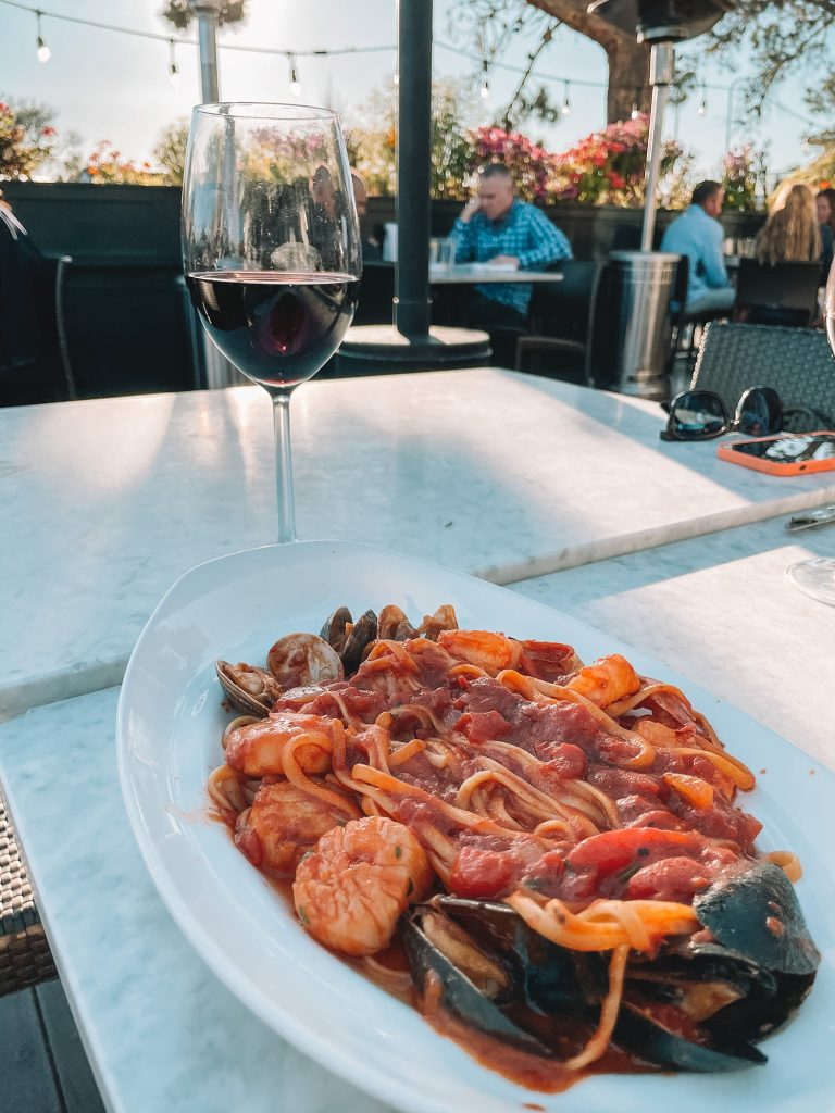 An Italian seafood dinner with red wine
