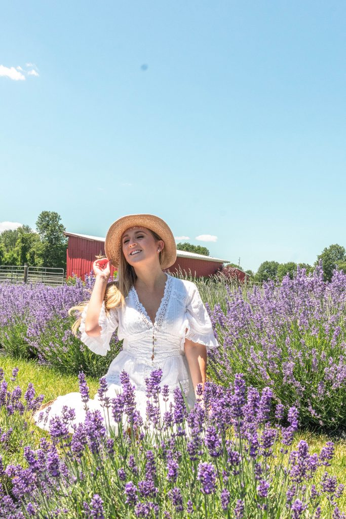 A woman enjoying a beautiful day at Hidden Spring Lavender Farm in Somerset County this summer