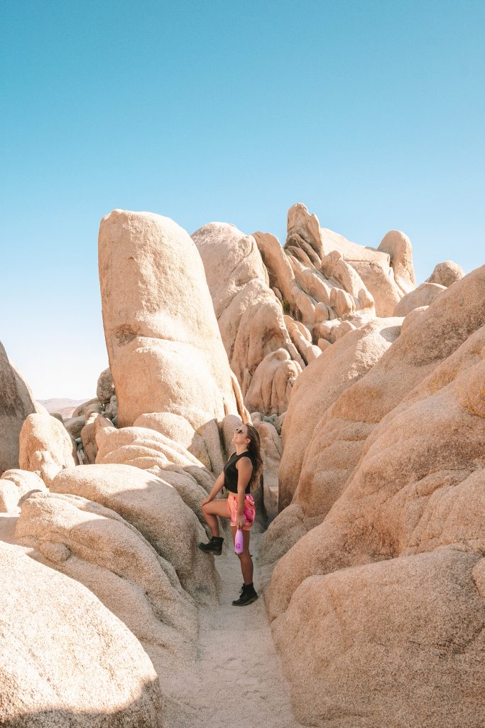 A woman hiking Arch Rock Trail in Joshua Tree National Park