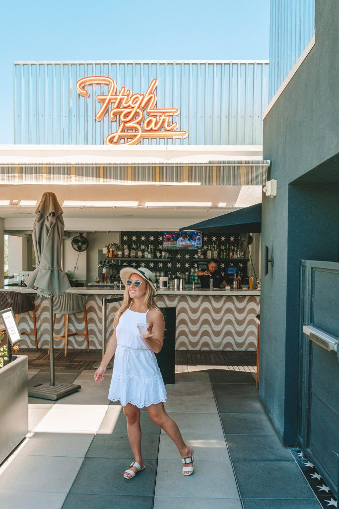 A woman enjoying a drink at High Bar in Palm Springs