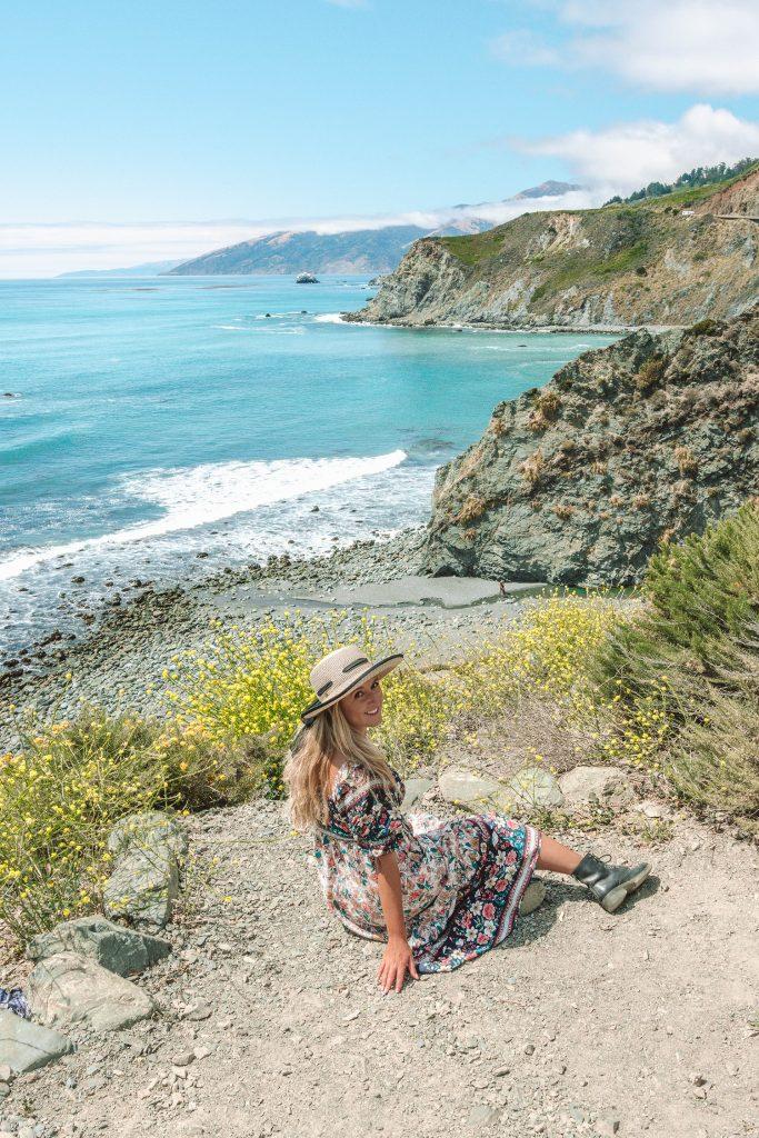 A woman enjoying the views along the Pacific Coast Highway on a Santa Barbara to San Francisco road trip