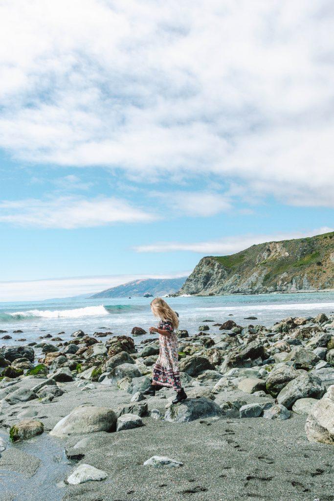 A woman enjoying a Santa Barbara to San Francisco road trip