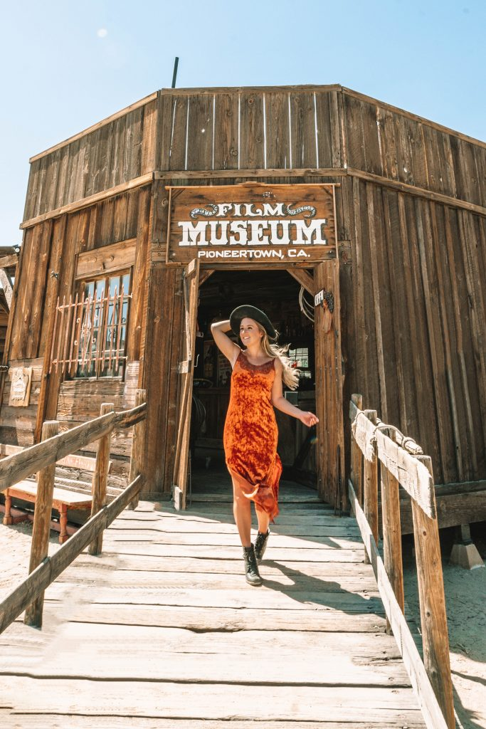 A woman at Pioneertown, California during a girls' trip to Palm Springs