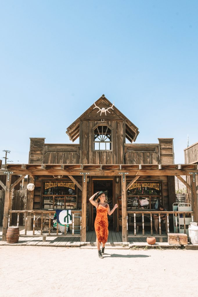 A woman exploring Pioneertown in California during a girls' trip to Palm Springs