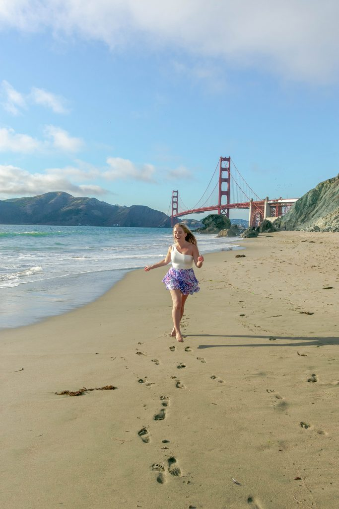 A woman laughing and having fun at Marshall's Beach in San Francisco