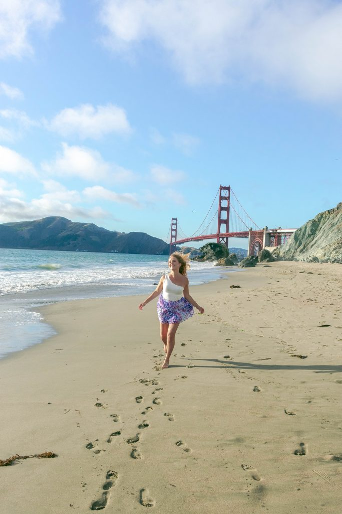 What to do during your first time in San Francisco - a woman running on Marshall's Beach