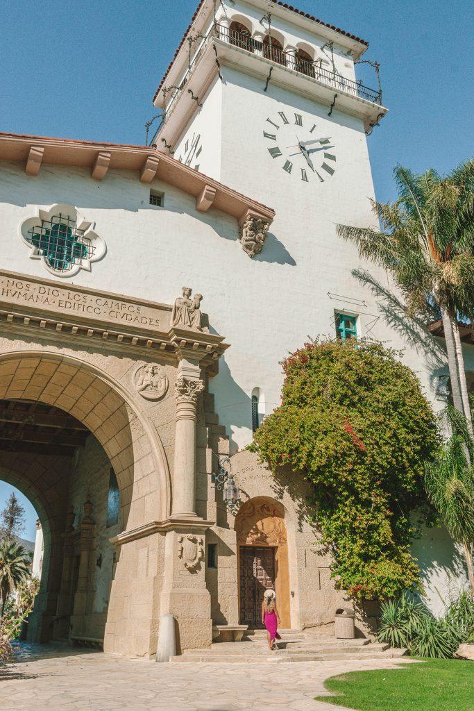 A woman admiring the beautiful Santa Barbara Courthouse during a Santa Barbara to San Francisco road trip