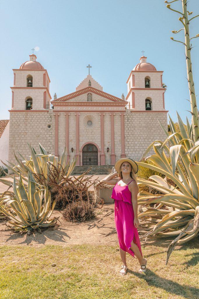 A woman at Old Mission Santa Barbara during a coastal road trip to San Francisco
