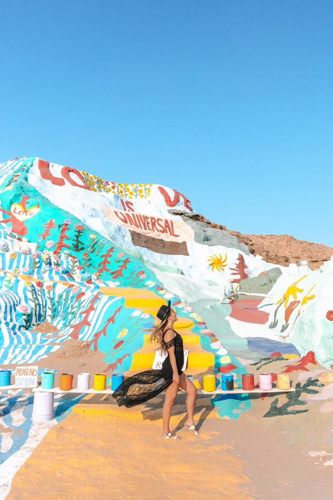 A woman enjoying a girls' trip to Palm Springs at Salvation Mountain