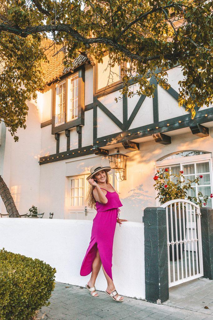 A woman enjoying an evening in Solvang during a Santa Barbara to San Francisco road trip