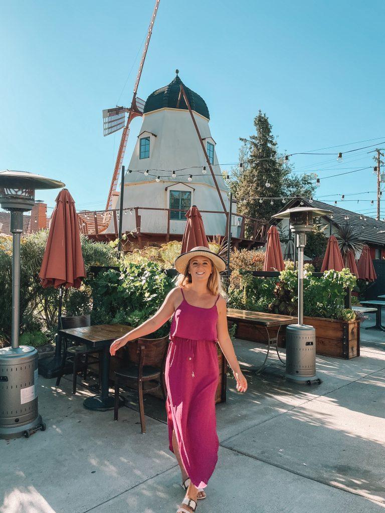 A woman enjoying Solvang during a Santa Barbara to San Francisco road trip