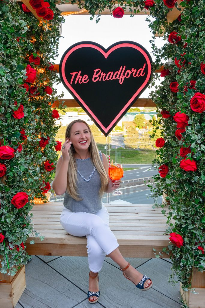 A woman enjoying a happy hour at The Bradford Rooftop this summer in Somerset County