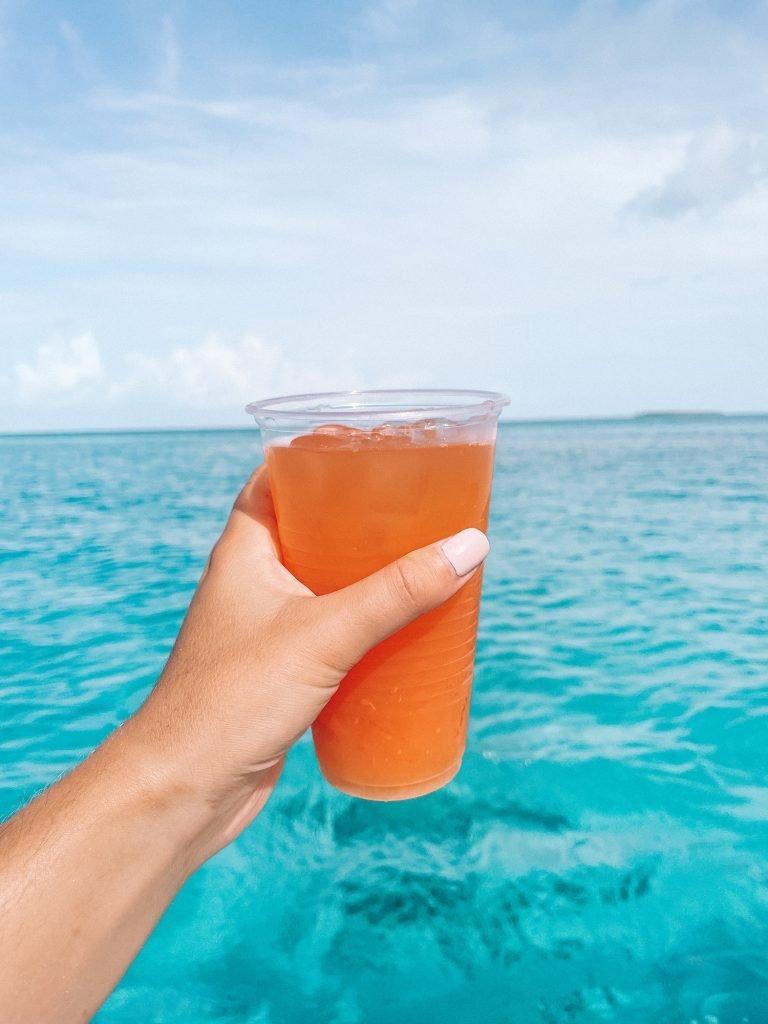 Drinking jungle juice on an Exuma Island boat tour