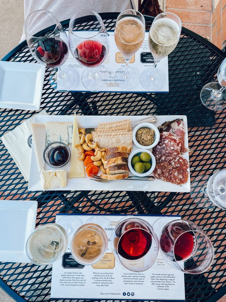 Enjoying a charcuterie board at Domaine Carneros during a California Wine Country road trip