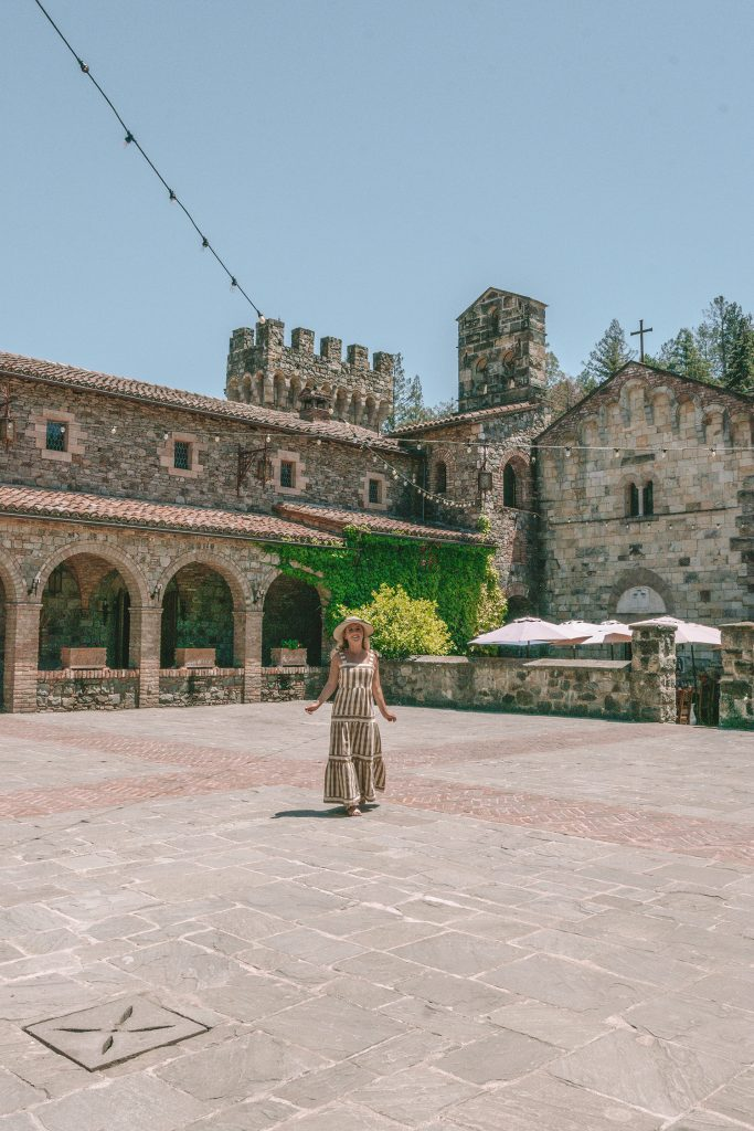 A woman enjoying a beautiful day at Castello di Amarosa in Napa