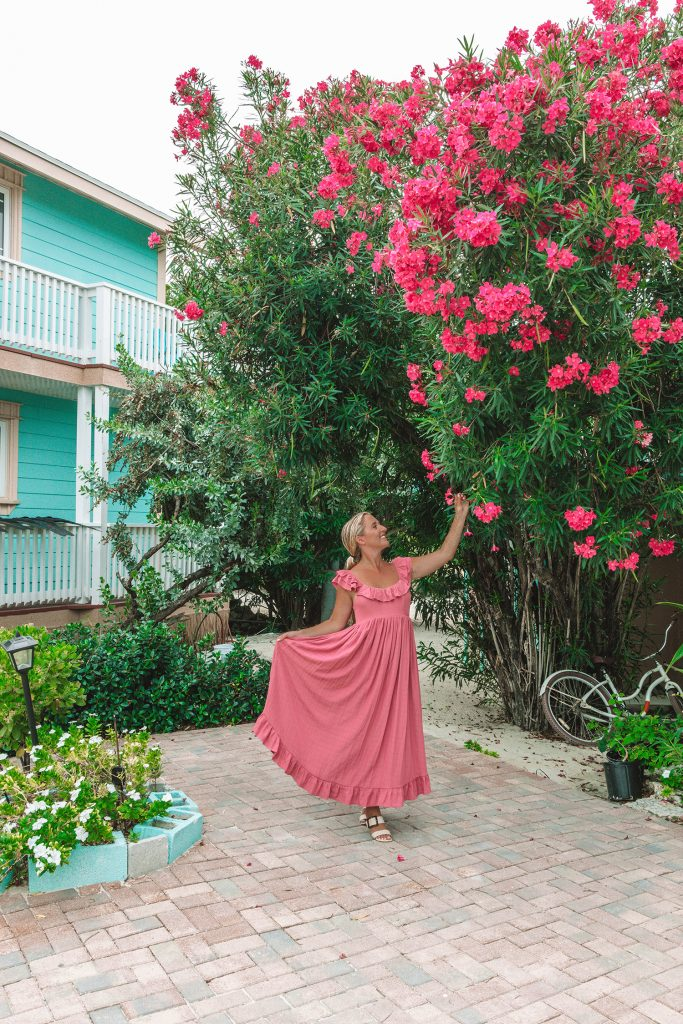A woman enjoying a stay at Embrace Resort on Staniel Cay