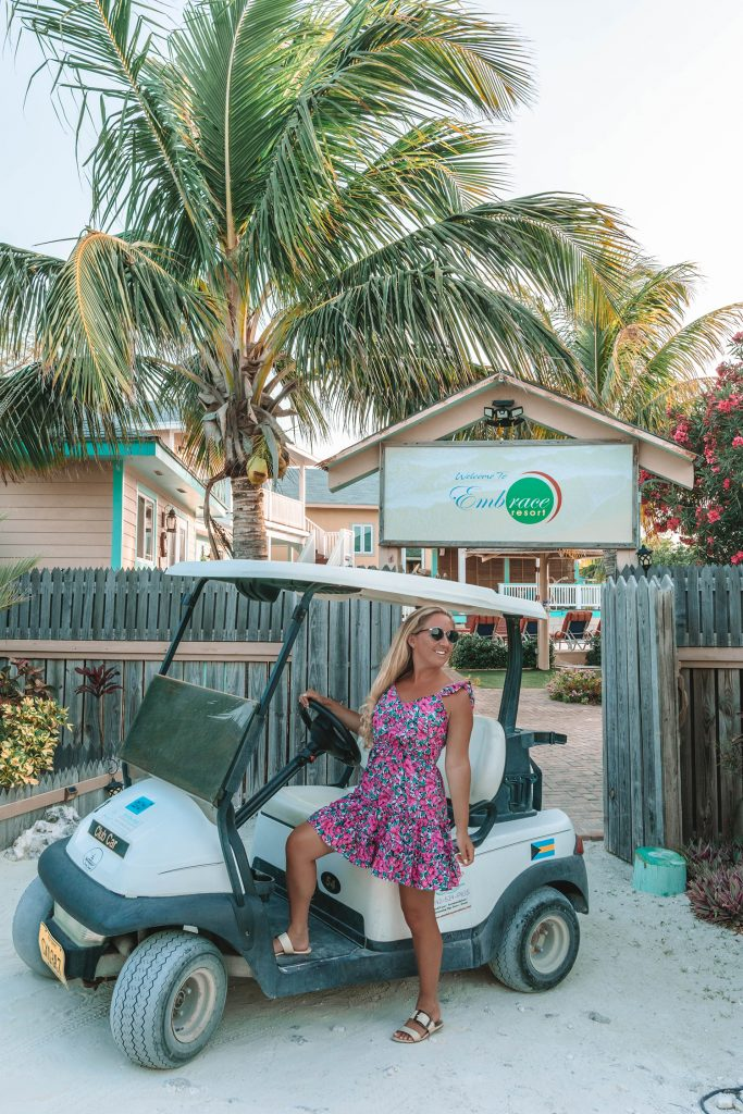 A woman taking a golf car around Staniel Cay from Embrace Resort