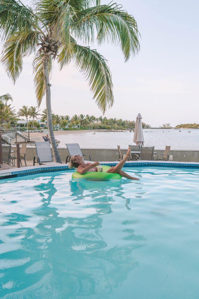 A woman enjoying a drink in the pool at Exuma Beach Resort
