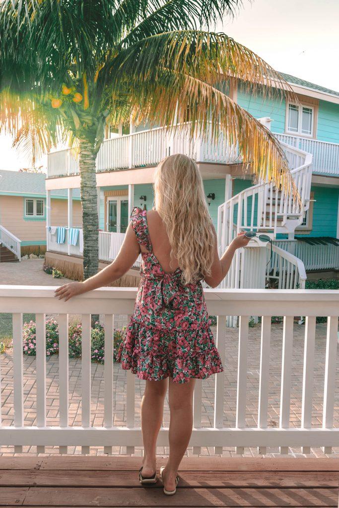 A woman enjoying an evening at Embrace Resort on Staniel Cay