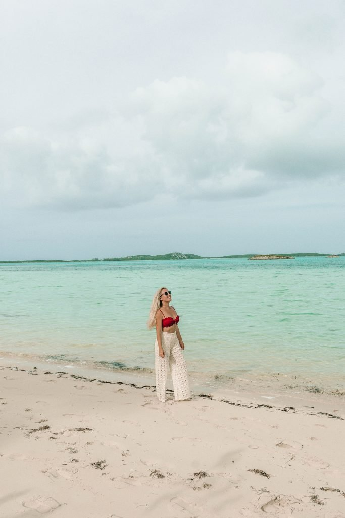 A woman on Palm Bay at Great Exuma Island